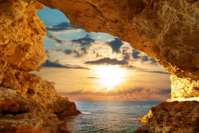 Sunset Through Coastline Cave Wall Mural